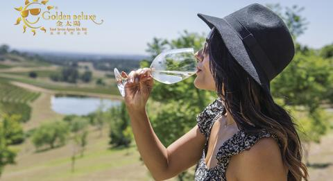 Woman enjoying the scenic views and wine at Bistro Molines, Mount View in the Hunter Valley.